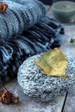 Plaid blanket. Gray plaid blanket with a stone and autumn leaves Stock Photography