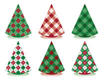 Plaid Christmas Trees. Stylized holiday trees patterned in plaid and argyle Stock Photos