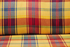 Plaid cushioned textile Stock Photos