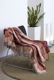 Plaid draped over a chair royalty free stock photo