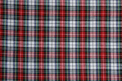 Plaid fabric. Red, white, black and green Christmas colored plaid fabric Royalty Free Stock Images