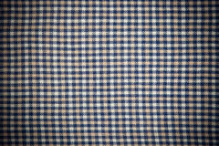 Plaid fabric as a background Stock Photos
