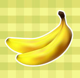Plaid fabric with bananas. Ripe bananas not bright yellow-green plaid fabric Royalty Free Stock Image