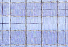Plaid fabric. Blue plaid fabric with large cells stock image