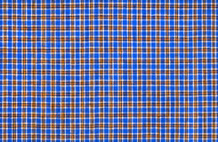 Plaid fabric. Blue plaid fabric with small cells stock photos