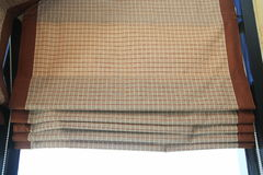 Plaid fabric curtain. Plaid fabric curtain,brown blinds fabric in house Royalty Free Stock Photo