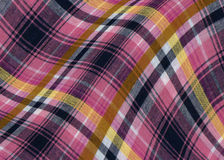 Plaid fabric with curves. In purple and yellow colours stock photography