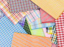Plaid fabric. Pile of colorful checkered plaid fabric background texture Stock Images