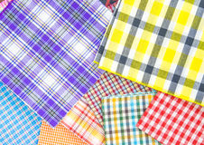 Plaid fabric. Pile of colorful checkered plaid fabric background texture Royalty Free Stock Photos