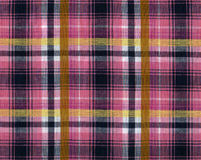 Plaid fabric. In purple and yellow colours stock photo