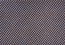 Plaid fabric. With small cells royalty free stock photo