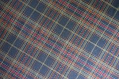 Plaid fabric in subdued colors. From above Stock Photography