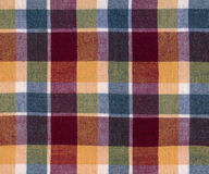 Plaid fabric. In warm colours stock photography