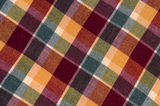 Plaid fabric. In warm colours royalty free stock photo