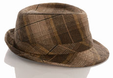 Plaid fedora. With reflection on white background royalty free stock photos