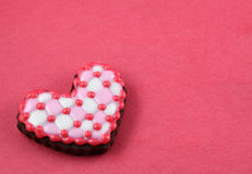 Plaid love cookie. Heart cookie on a red background Stock Photo