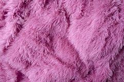 Plaid moderno rosa lanuginoso come fondo fotografia stock libera da diritti