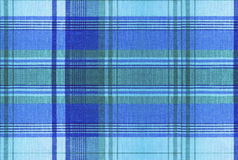 Plaid pattern - Tartan Clothing Table. Plaid is a pattern consisting of crossed horizontal and vertical bands in two or more colours in woven cloth Royalty Free Stock Photos