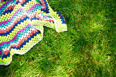 Plaid for picnic on green grass Royalty Free Stock Photos