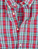 Plaid shirt. Checked red casual man's shirt with details of buttons Stock Photography