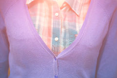 Plaid shirt and blue sweater on the girl. Royalty Free Stock Photo