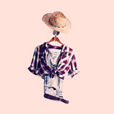 Plaid Shirt and Jeans on Hanger with Sunhat Royalty Free Stock Images
