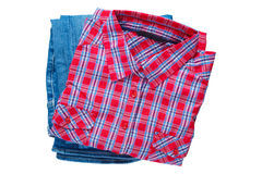 Plaid shirt and pair of jeans isolated on white Royalty Free Stock Image