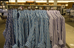 Plaid shirts in men clothing department store stock photos