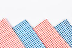 Plaid table napkins, white background. Collection of red and blue checkered tablecloth on white background close up. Row of vintage table napkins Stock Photo