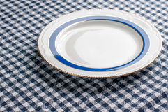 Plaid tablecloth and a plate Royalty Free Stock Image