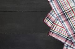 Tablecloth. The plaid tartan tablecloth on black wooden table in top view Stock Photography