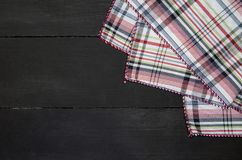 Tablecloth. The plaid tartan tablecloth on black wooden table in top view Stock Photos