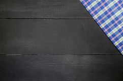 Tablecloth. The plaid tartan tablecloth on black wooden table in top view Royalty Free Stock Photography