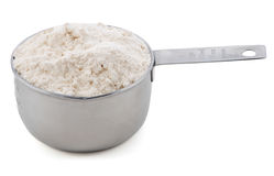 Plain / all purpose flour presented in an American cup measure Stock Images