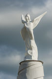 Plain angel statue on a dark sky background Stock Photography