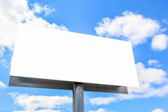 Plain billboard sign. Blank billboard sign with blue sky and clouds stock image