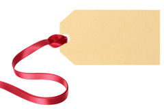 Plain blank gift tag or manila label with red ribbon isolated on white background, copy space Stock Image