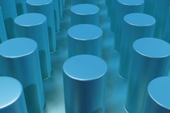 Plain blue surface with cylinders Royalty Free Stock Image