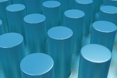 Plain blue surface with cylinders Royalty Free Stock Images