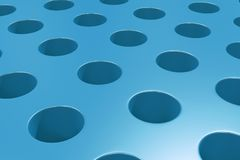 Plain blue surface with cylindrical holes Stock Photo