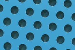 Plain blue surface with cylindrical holes Royalty Free Stock Images