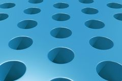 Plain blue surface with cylindrical holes Royalty Free Stock Photography