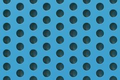 Plain blue surface with cylindrical holes Royalty Free Stock Image