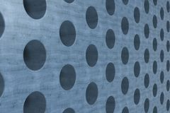 Plain blue wooden surface with cylindrical holes Stock Photography