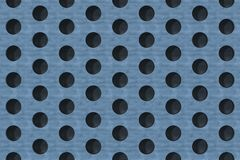 Plain blue wooden surface with cylindrical holes Stock Image