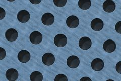 Plain blue wooden surface with cylindrical holes Royalty Free Stock Image