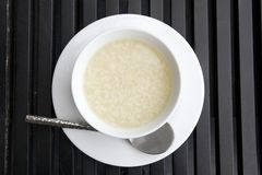 Plain boil rice. Top view of a bowl of boil rice on dark wood table Stock Photo