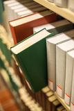 A plain book in a bookshelf Royalty Free Stock Image