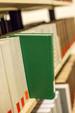 A plain book in a bookshelf Stock Images