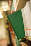 A plain book in a bookshelf Royalty Free Stock Photo